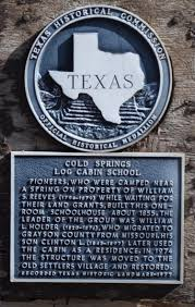 Texas Historical Marker Plaque commemorating Cold Springs Log Cabin. First erected in the 1850s.