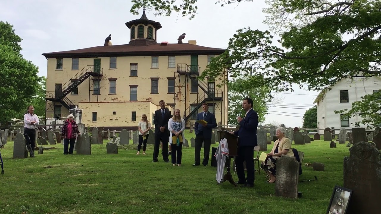 Bacon Academy Principal Matthew Peel during the Founder's Day Celebration at the gravesite of Pierpont Bacon at the rear of the Old Bacon Academy building in 2018.