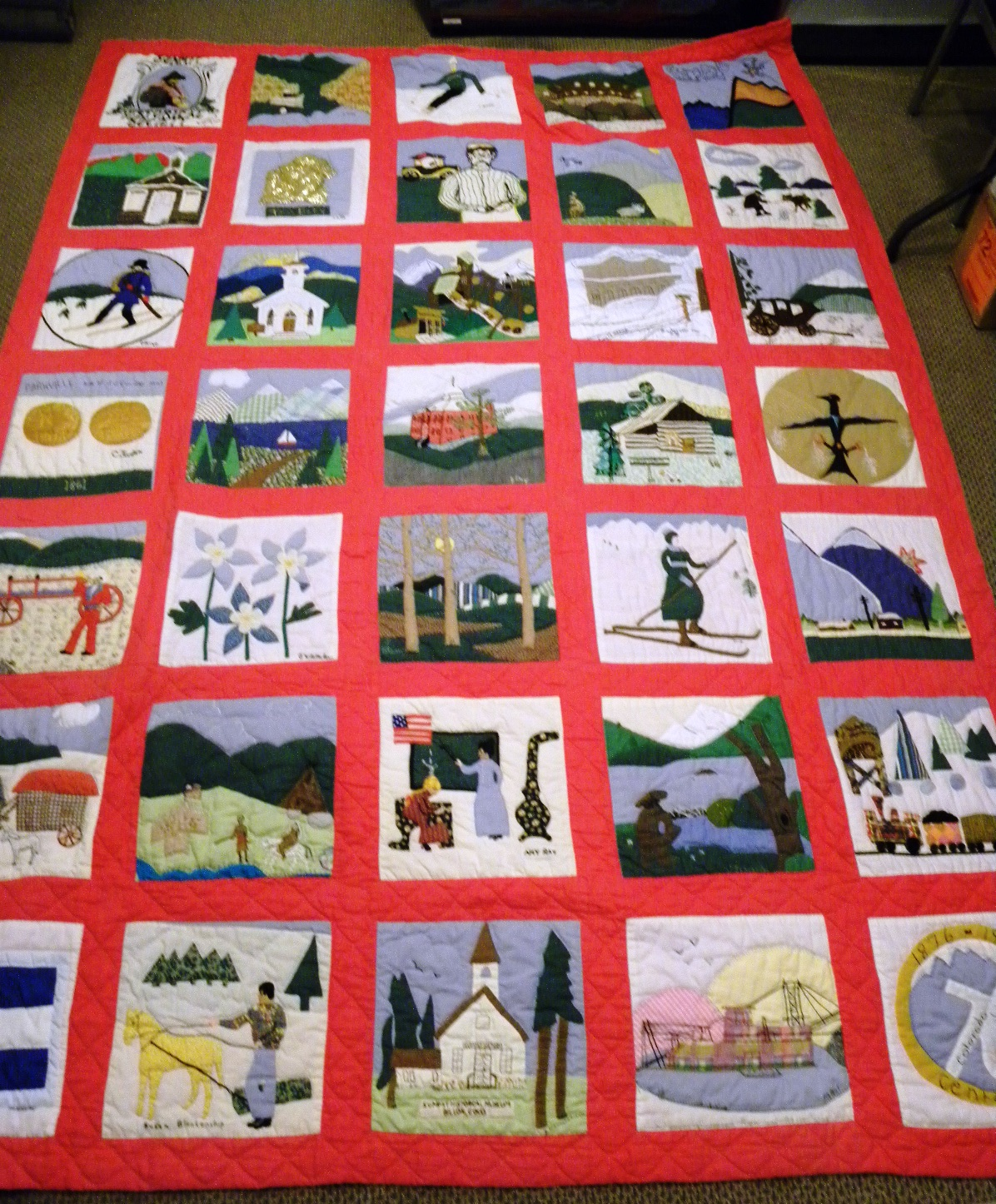 A quilt crafted for the 1976 Colorado Centennial celebration raffle. It has 35 quilted blocks depicting Summit County and Colorado motifs. Most blocks have the signature of the sewer.