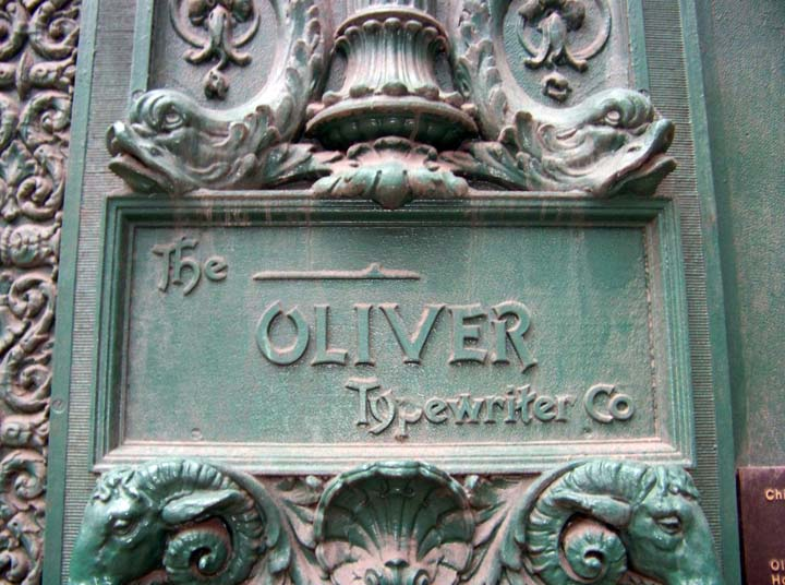 The nameplate that remains in place on the front facade, despite the building now existing as part of the James M. Nederlander Theatre