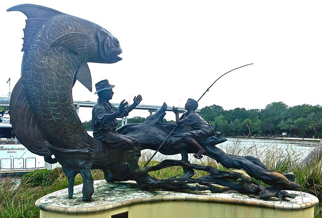 "Bronze sculpture ""Fish Story"" by Paul Baliker. Now located on Mariners Hospital's campus. Credit: Readerwalker, Flickr"