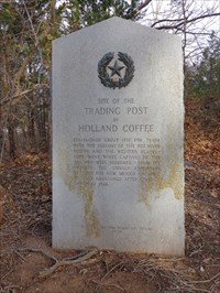 The historical marker for Coffee Trading Post and the gravesite of Holland Coffee.