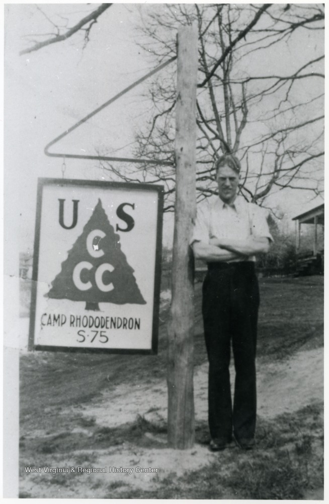 A Camp Rhododendron member with a CCC sign