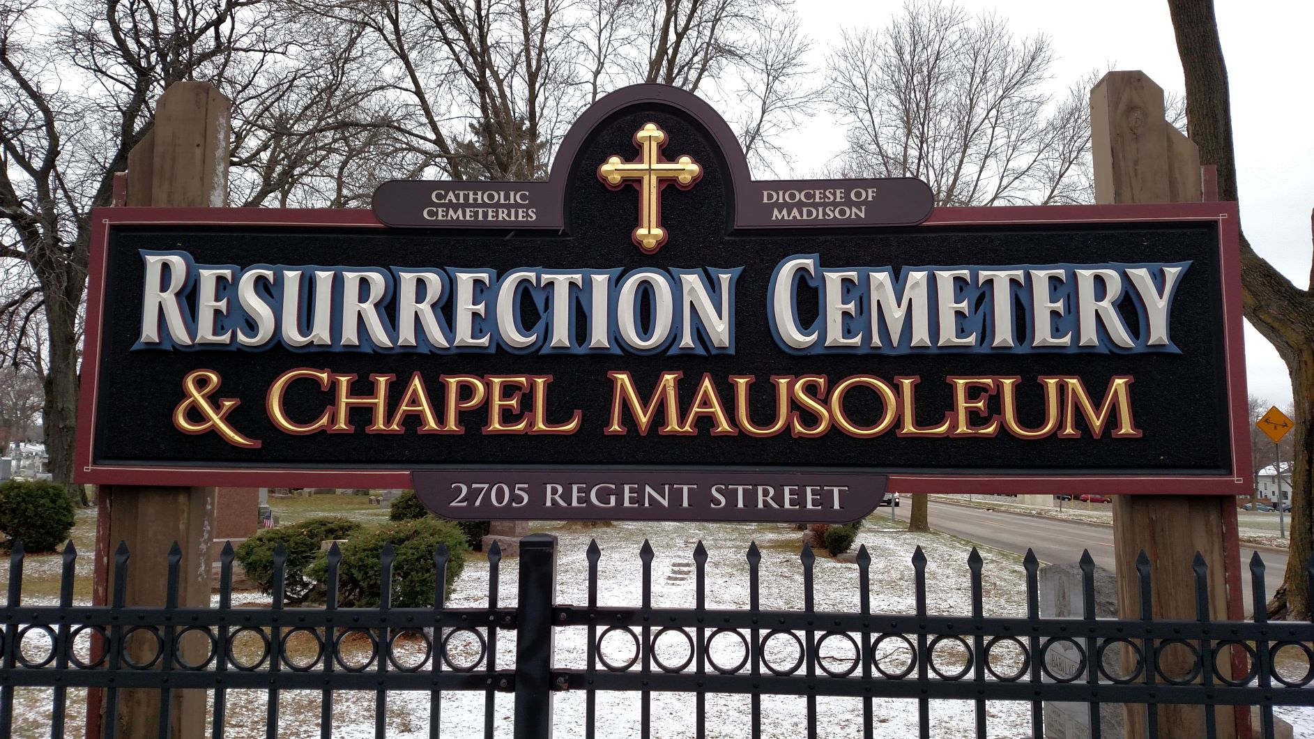 Sign for Resurrection Cemetery, located at the corner of Regent Street and Speedway Road. Photo by Peter Wagner