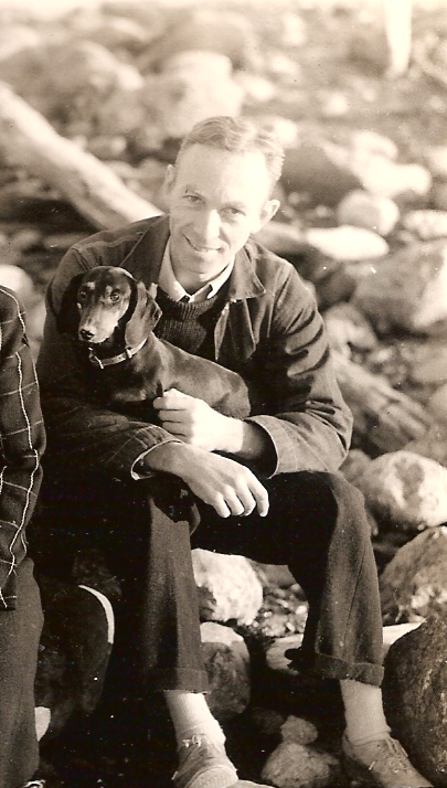 E. B. White with his dog, Minnie, on the coast of Maine.   Photo by White Literary LLC via Wikimedia Commons.