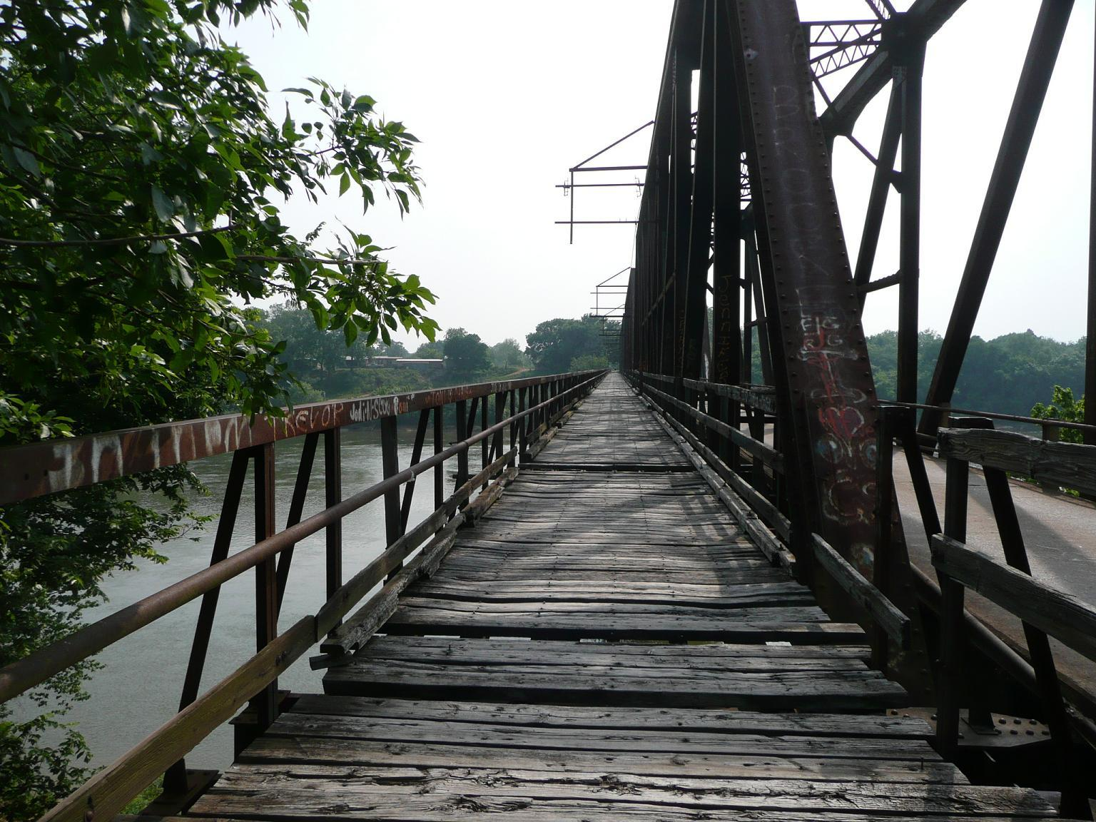 This photo shows the reason the wooden walkway was closed years ago. Its now many missing wooden planks create a major safety hazard to visitors.