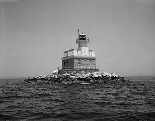 Penfield Reef Lighthouse seen from the shore of Bridgeport, Connecticut. The lighthouse is located roughly 1.3 miles offshore.