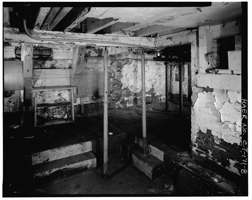 The first floor of Penfield Reef Lighthouse circa 1950. The lighthouse experienced neglect in the mid-20th century before seeing renovations in the 1990s and 2000s.