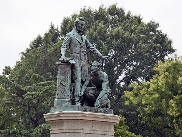 """From the perspective of many historians, the statue's design fails to accurately reflect the nature of emancipation during the Civil War by portraying freedom as something that was """"given"""" to former slaves by Executive action."""