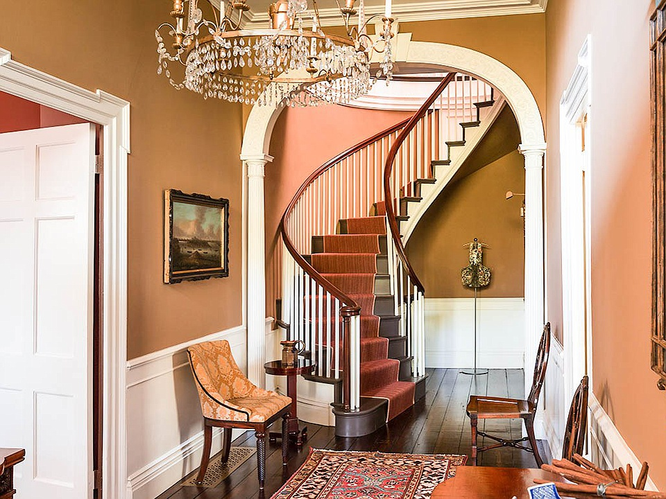 The home's central hallway and spiral staircase to the second floor.