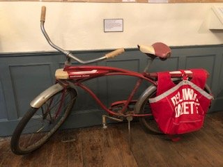 This is a real newsboy's bike donated to the historical society by a Delaware local.