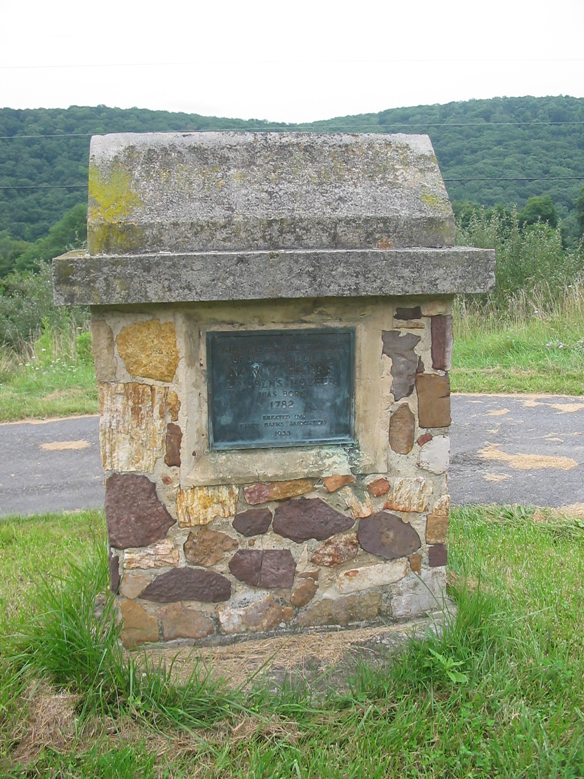 This stone monument and plaque were erected in 1933 designating the site as the birthplace of Nancy Hanks Lincoln. Image obtained from Ser Amantio di Nicolao, Wikipedia.