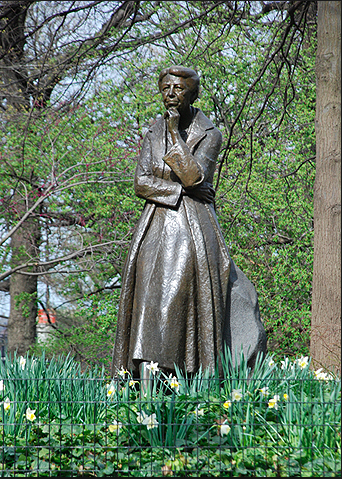 Eleanor Roosevelt Statue surrounded by Spring Easter Lilies