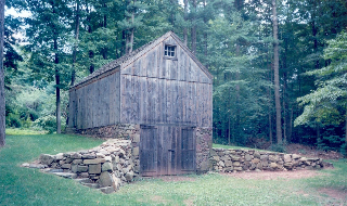 "According to the Historic Building Survey conducted in 1986, the Connecticut Historic Commission described the Talmadge Dickerman cider barn as ""one of the most interesting and best preserved early agricultural buildings remaining in Hamden. The heavy, hand-hewn timber framing makes it unlikely that the building was built later than the first years of the 19th century."""
