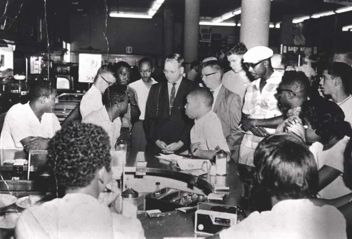 "Photo Credit: Provided by Rodney Hurst: ""Rodney Hurst (center right), who was 16 at the time, sits at the Woolworth's counter in August 1960. """