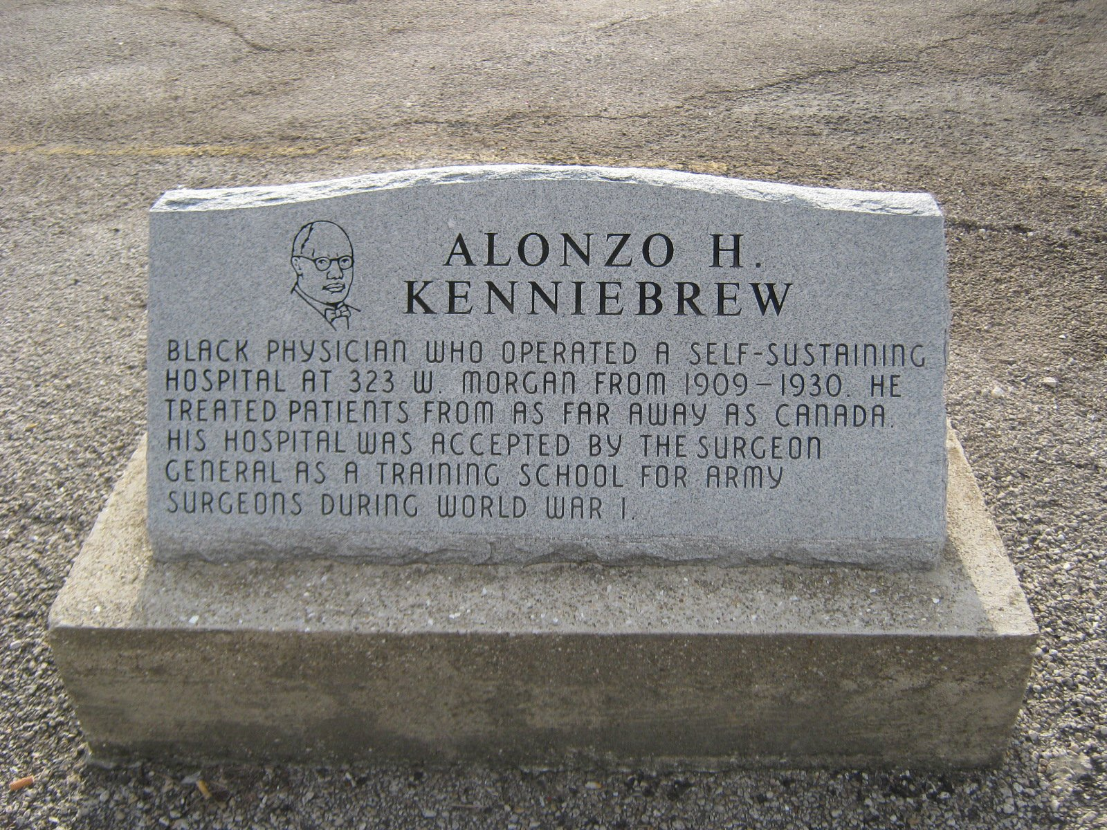 A memorial stone built for Dr. Alonzo Kenniebrew.
