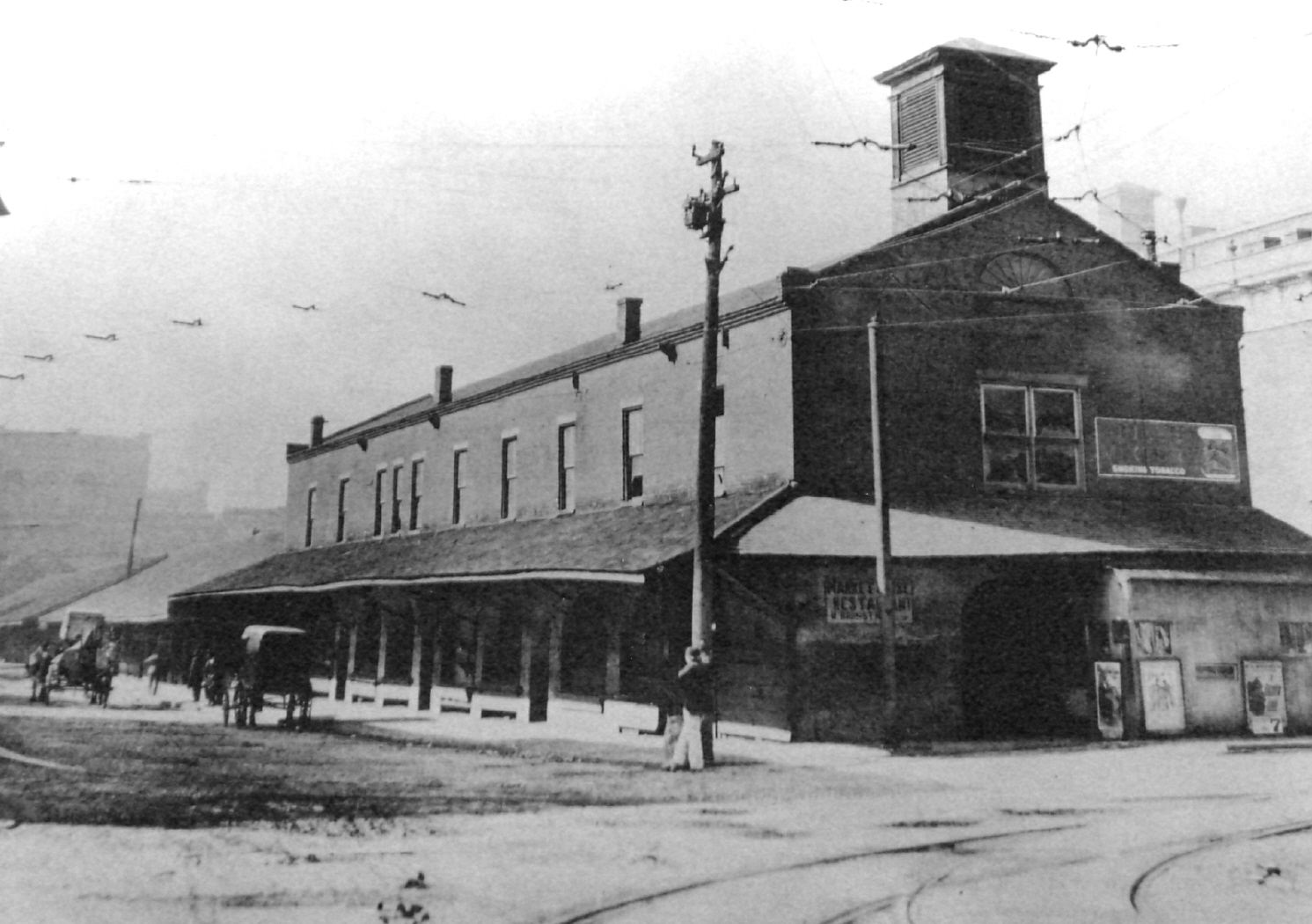 A turn-of-the-century view of the former town market which at that time also included a restaurant. Image from the Wheeling Public Library.