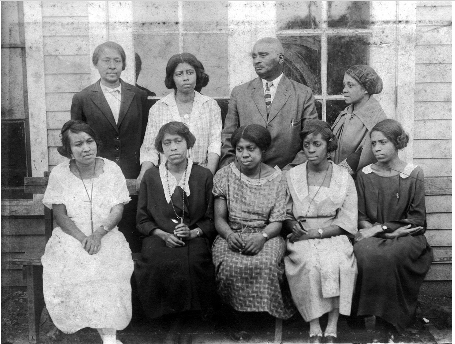 1921 Franklin Training School Principal and Teachers. Standing, Left to Right, Carrie Otey, Edna Hughes, J.K. Hughes (Principal), Julie Williams, sitting: Irene Williams, Mattie Stewart, Patty Carter, Patti Davis, Carrie L. Ridley.