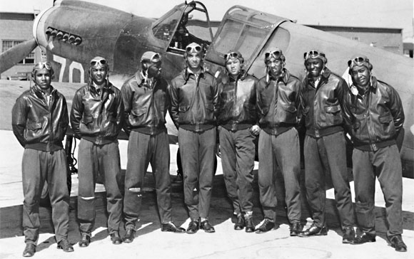 A group of Tuskegee Airmen poses for a photo.