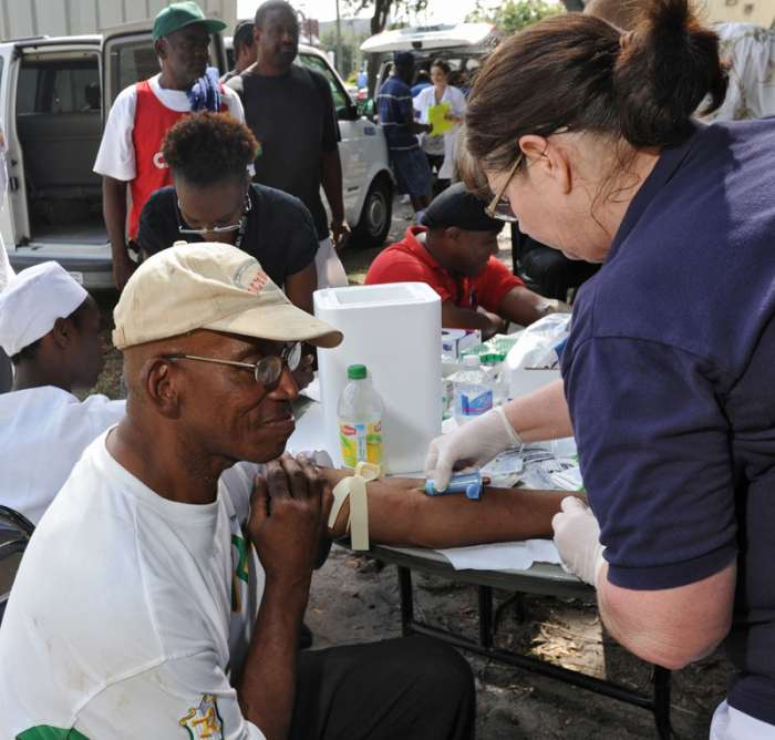 Photo Credit: Bob Mack/The Times-Union. County Health Department Set up tuberculosis screening station behind Clara White Mission downtown.
