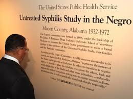 A visitor to the museum reads about they syphilis study.