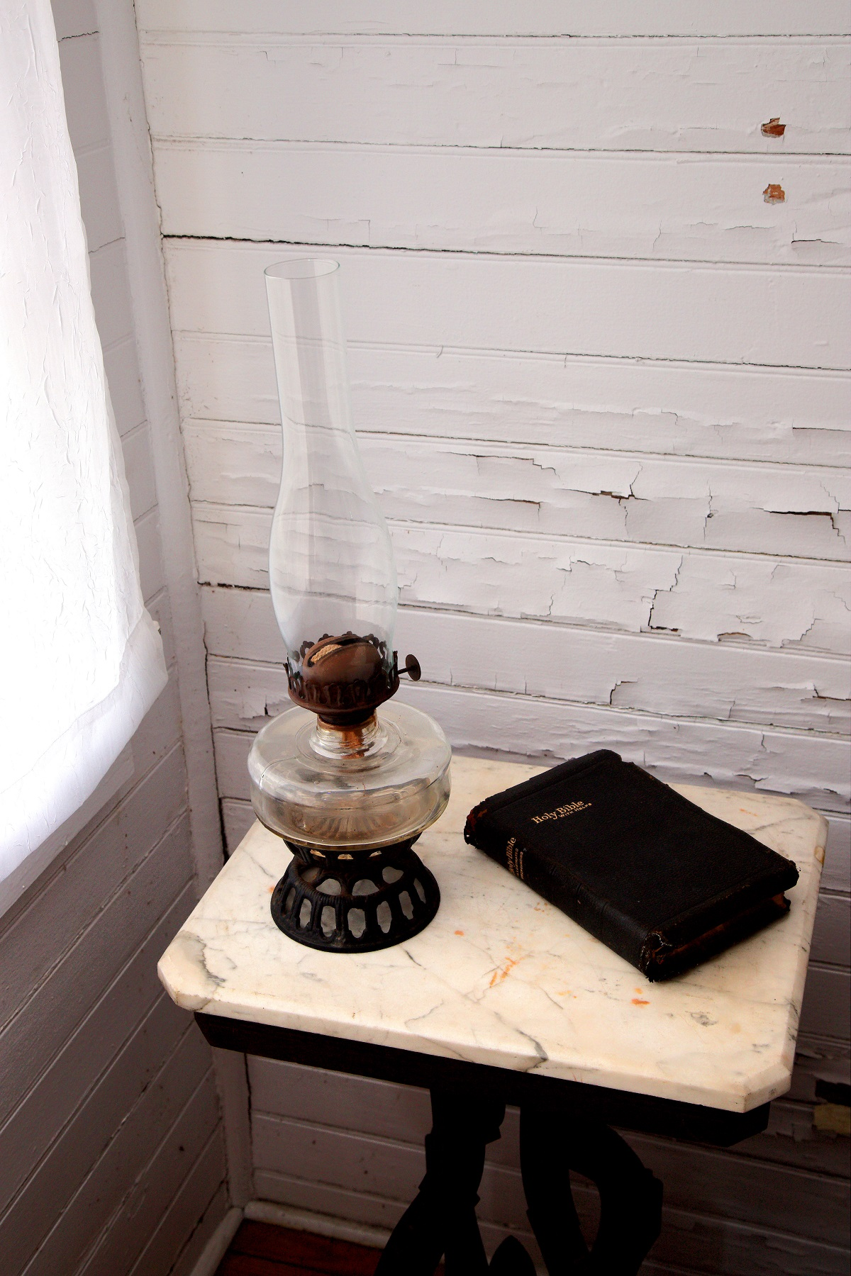 Lantern and Bible on Marbletop table