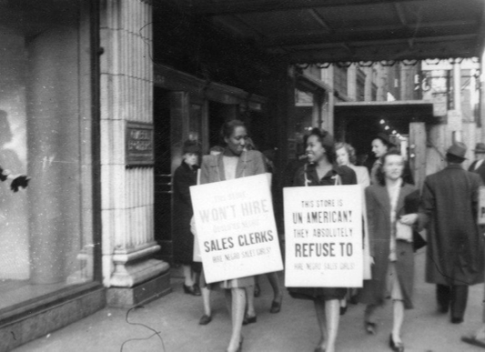 Women protesting Gimbels Department Store for refusing to hire black women.