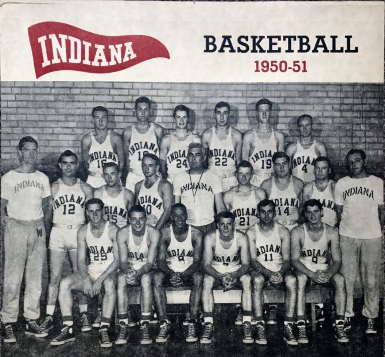 "This photo of the 1950-1951 Indiana Hoosiers photographs Bill Garrett as the only African American player. Coach Branch McCracken (center) offered Garrett an ""opportunity"" to make the team by proving himself in the fall of 1947, Garrett's freshman year."
