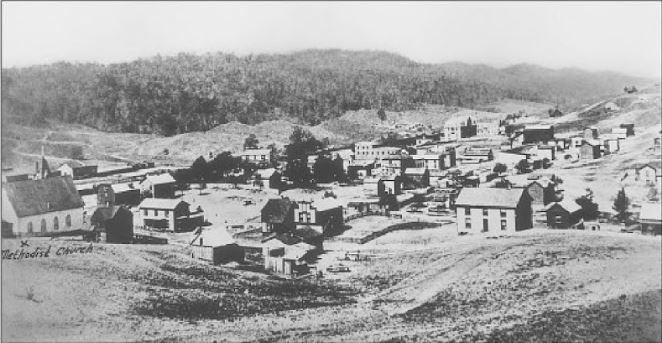 The church is Bland Street Methodist, and the knoll in the back center is where the Bailey Building now stands. Photo from Bluefield by William R. Archer.