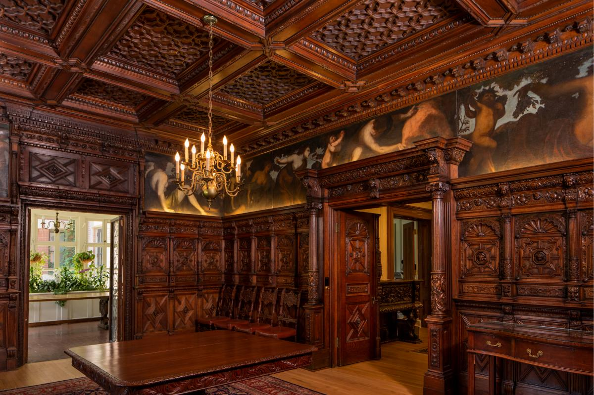 The interior features ornate woodwork.