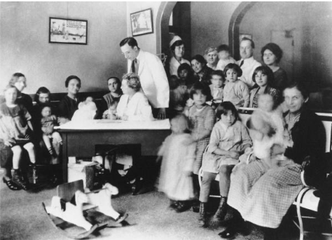 Dr. Florence Seibert sitting at a desk in the Phipps Institute Children's Clinic in Philadelphia, PA.