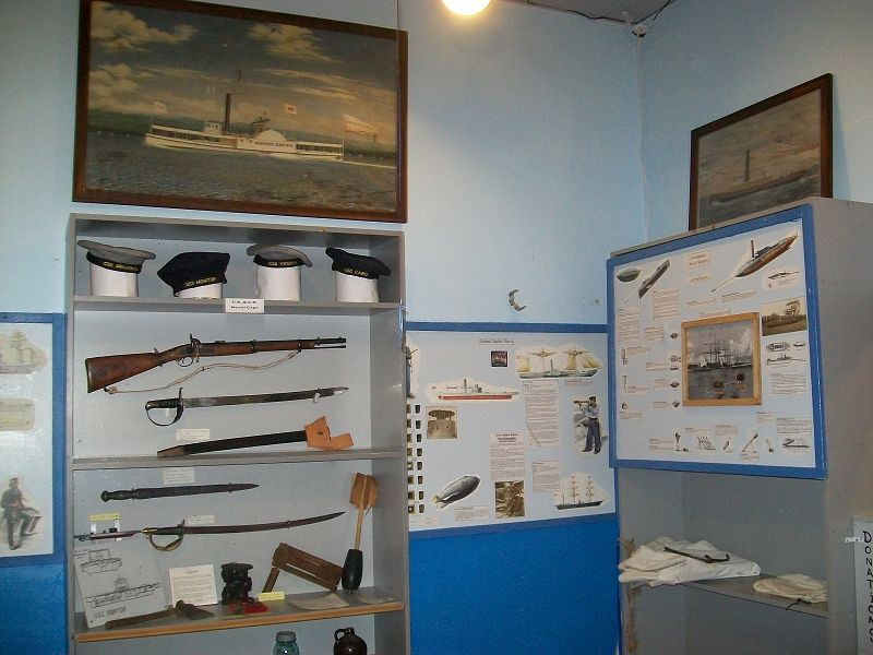 Rifles and other weapons are on display.