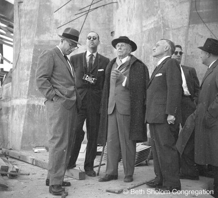 Frank Lloyd Wright (center, with overcoat) and Rabbi Cohen (to Wright's left) inspect the synagogue during its construction.