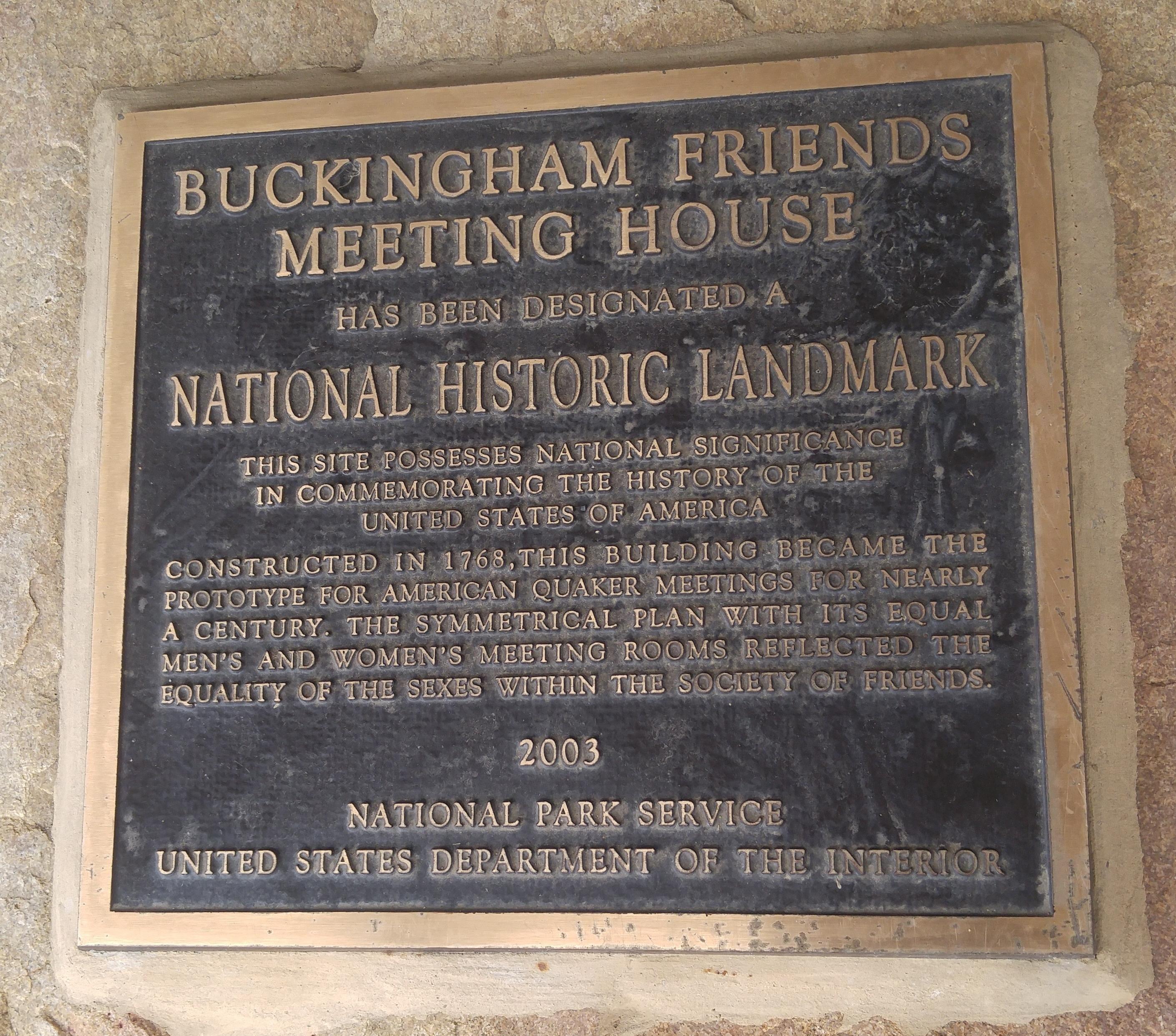 The National Historic Landmark plaque that adorns the building's exterior.