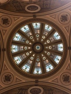 This is the Stain Glass Ceiling, 40 feet in diameter and 30 feet tall, that hovers over the grand central stairway. Some of the glass is up to three inches thick.
