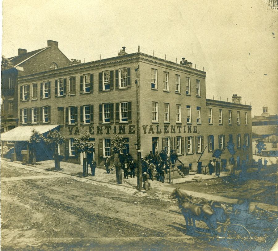 This picture was taken after the three story building was constructed and before it burned down in 1899.