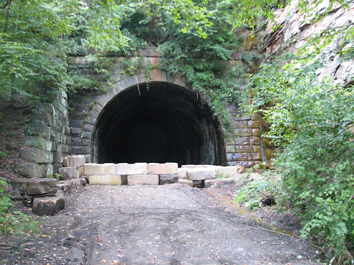 This is one of the entrances to Brady's tunnel which was in operation from 1916 until 2010 when Land Trust bought the railroad corridor and tunnel.