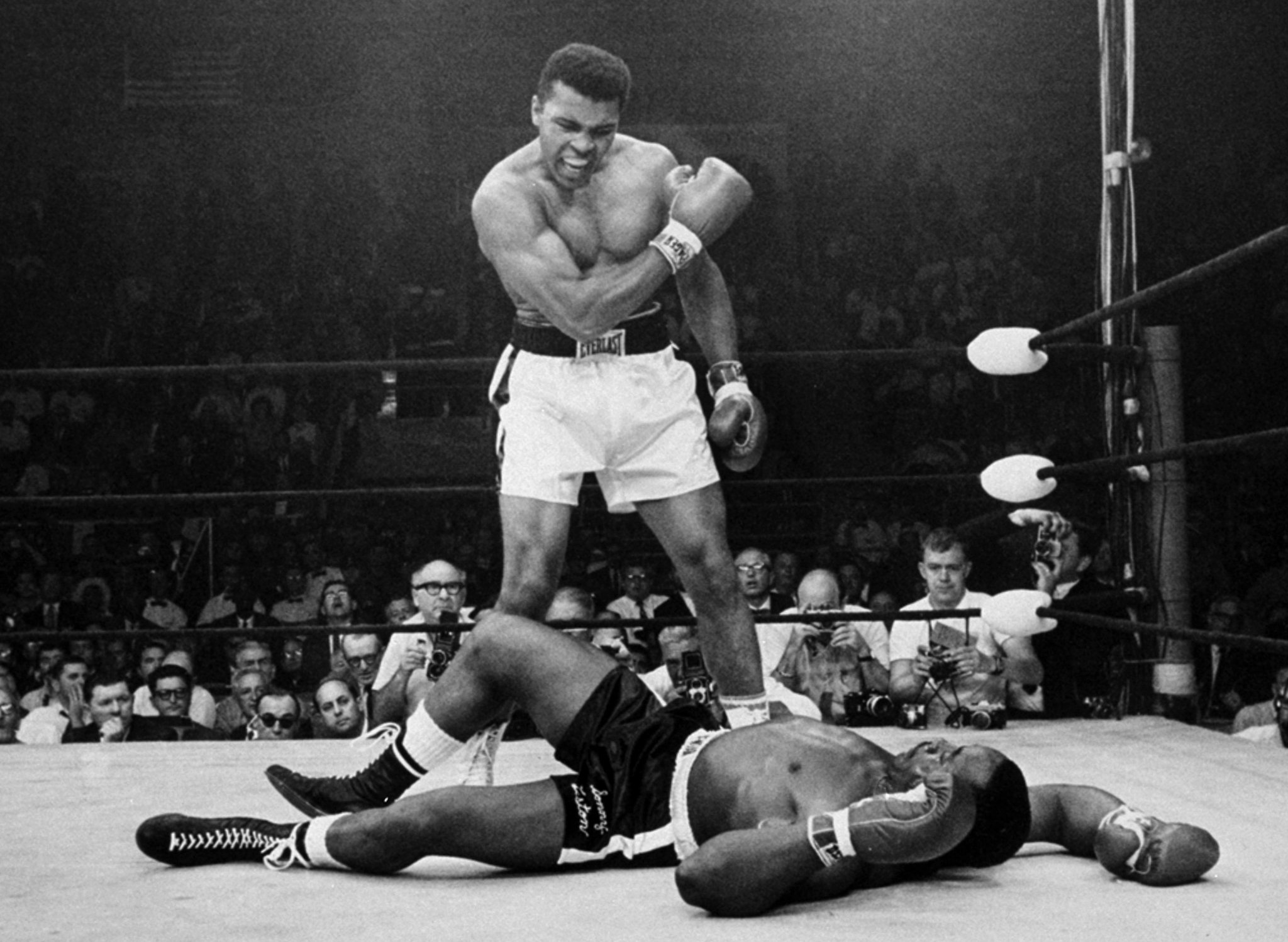 This is the picture of Muhammad Ali standing over Sonny Liston after one minute in the ring; he won this fight on his own with nobody on his side. After telling the world of his religion he lost all the people that once backed him, Sonny had gained all of Ali's previous followers because if you did support him you were just as bad as he was. People hated this picture because you could see Ali's dominance, this shows his passion and the strength of the main that had just been victorious.
