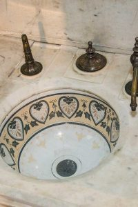The sink of the Billiards Room washroom