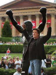 Actor Sylvester Stallone in front of the Rocky Sculpture.