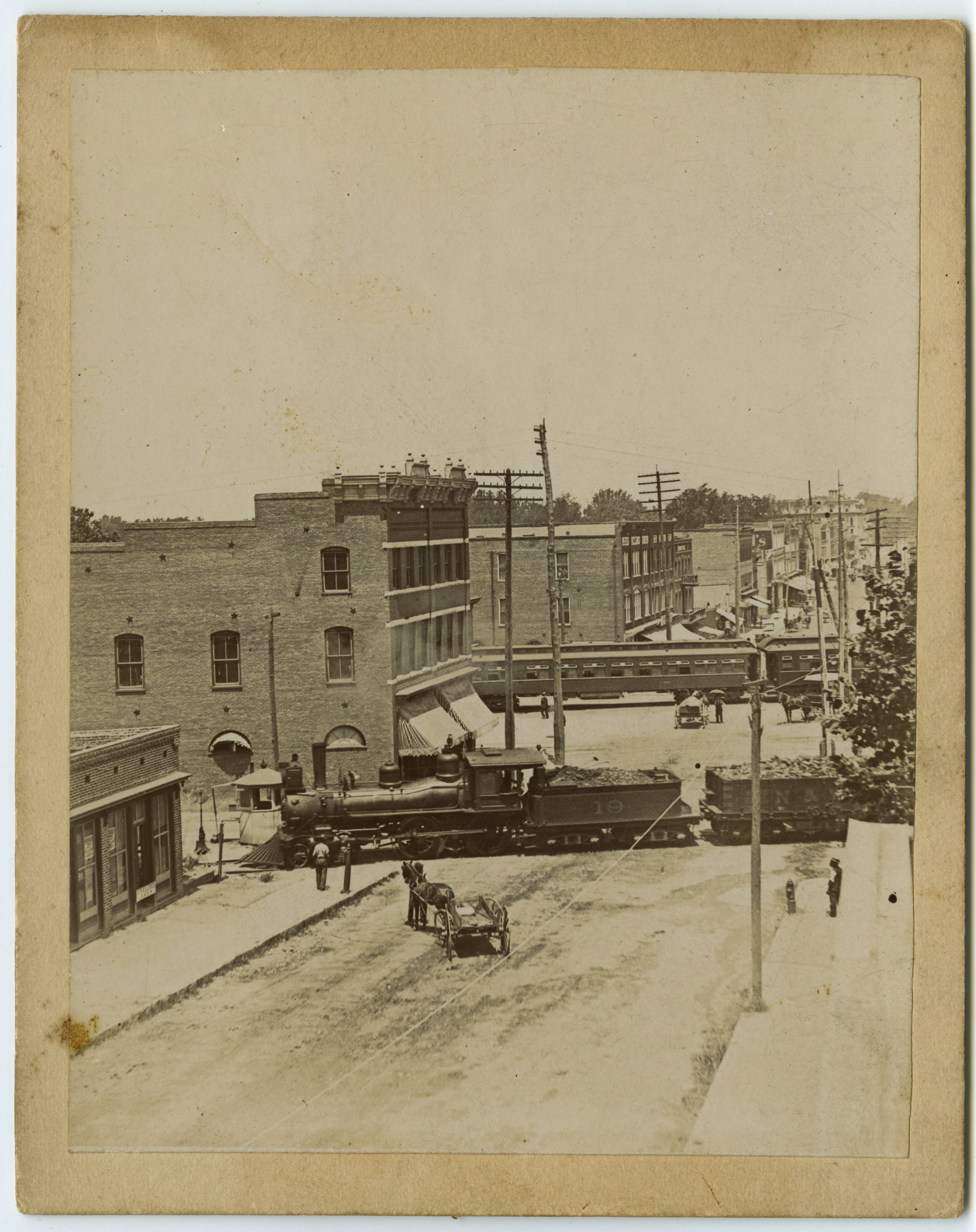 S. Elm St. railroad crossings, ca. 1900. Building slightly left of center is the Cascade Saloon.