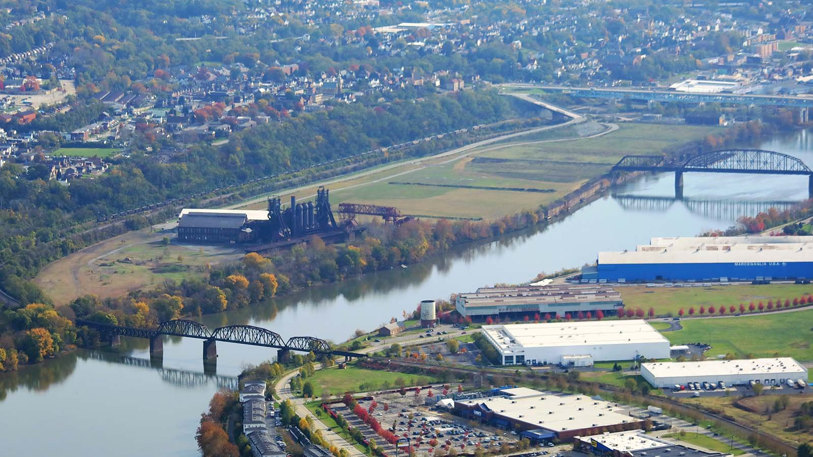 An aerial photo of the site.  The Hot Metal Bridge (far right) once carried torpedo cars of molten iron across the Monongahela River.