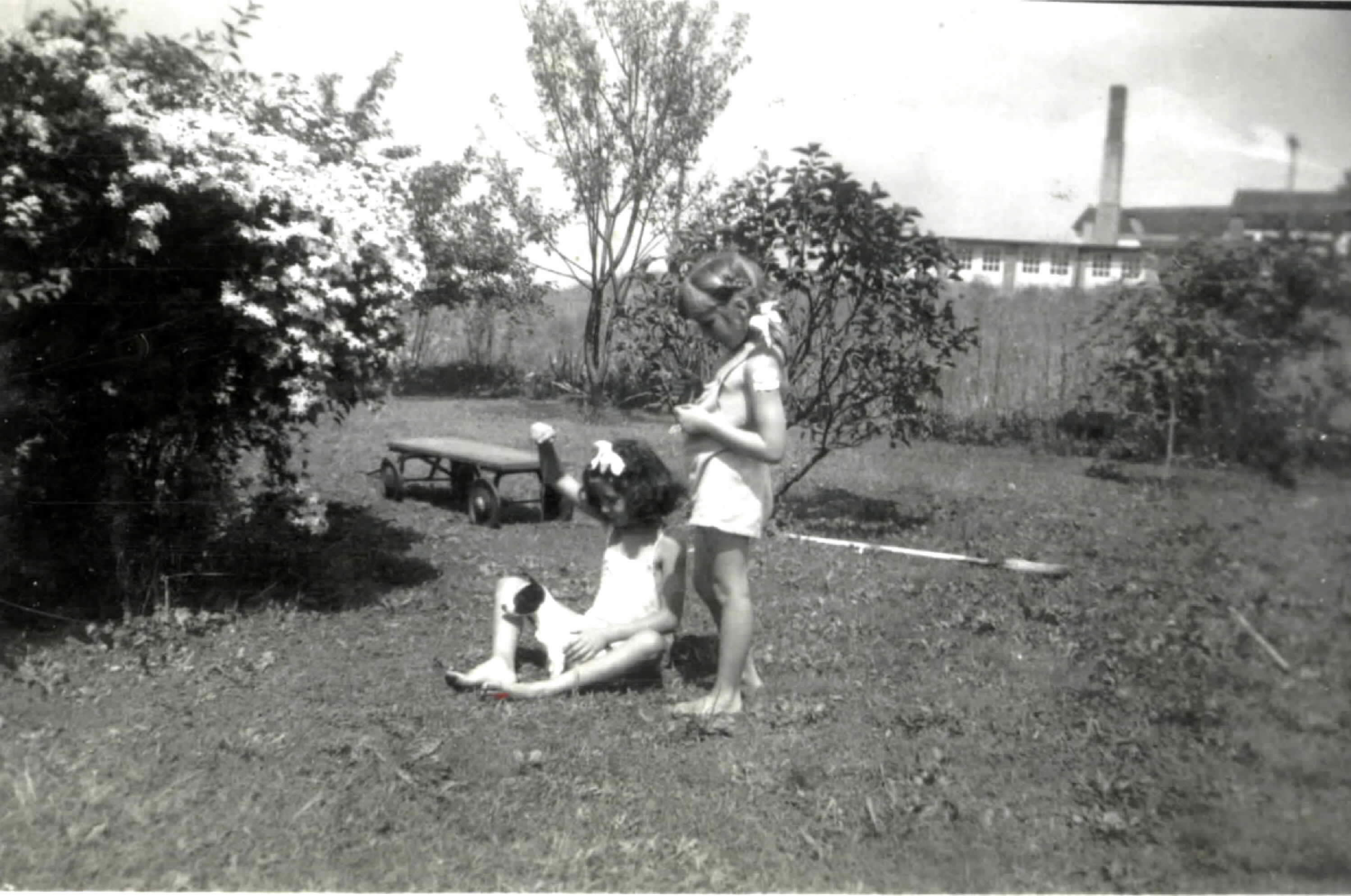 Jan and Joyce Ammons playing in E-15 yard near garden