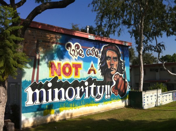 "One of the notable murals from the Estrada Courts Projects stating, ""We are Not a Minority!!"""