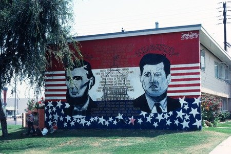 One of the Estrada Courts murals depicting Presidents Lincoln and Kennedy.