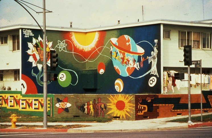 "Estrada Courts' mural ""Give Me Life"" painted by Charles ""Cat"" Felix and the Children of the World."