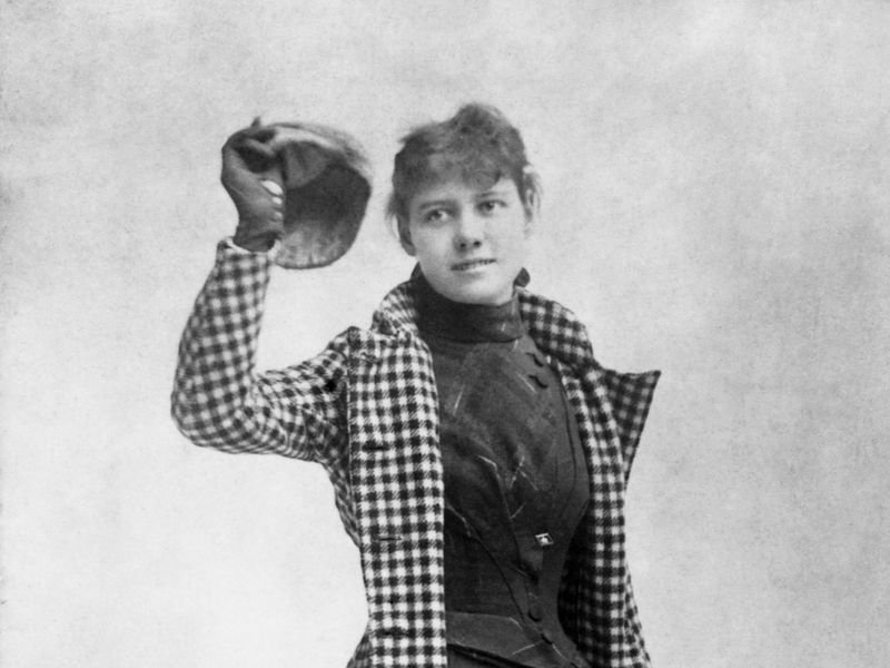 Photographed is Nellie Bly, the courageous journalist known for her undercover stunts, trip around the world in 72 days, and her deep concern for social justice issues and the well-being of others. She was born May 5, 1864 in Pennsylvania and died on