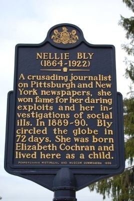 Nellie Bly's historical marker was erected in 1995. It honors Nellie Bly, the journalist known for traveling the entire world in 72 days, and her undercover stunts to expose social justice issues. The marker stands in front of Bly's childhood home in