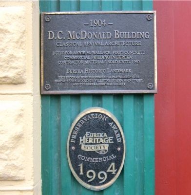 Historical marker mounted on pilaster, left side of entryway