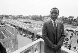 Mayor Wilson Goode Stands on the Roof of One of the Rebuilt Homes